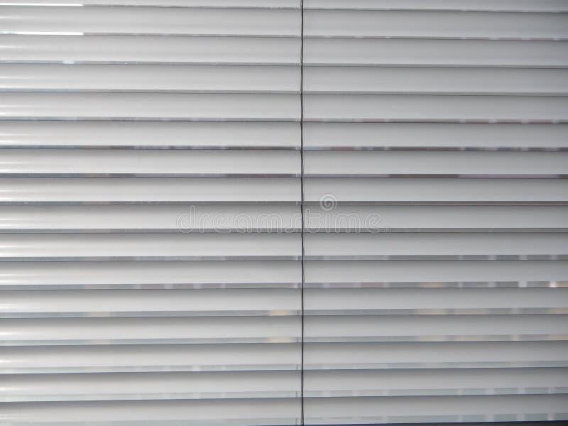 Máscara de uma textura dos antolhos da janela fotos de stock