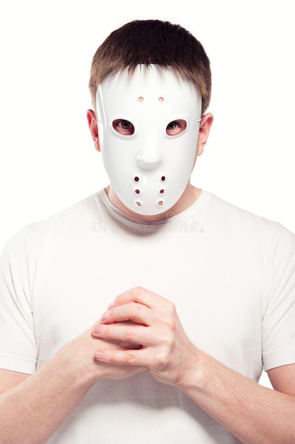 Máscara del hockey del hombre que desgasta fotografía de archivo