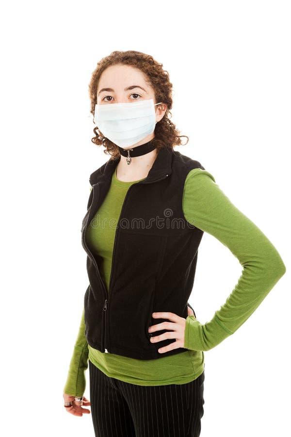 Máscara desgastando adolescente da gripe foto de stock royalty free