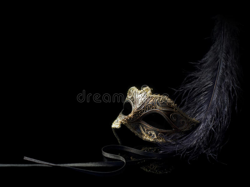 Máscara do carnaval isolada no preto fotografia de stock
