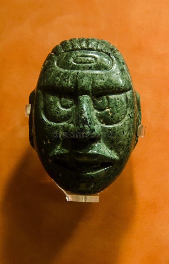 Máscara maya antigua del jade con los grandes ojos imágenes de archivo libres de regalías