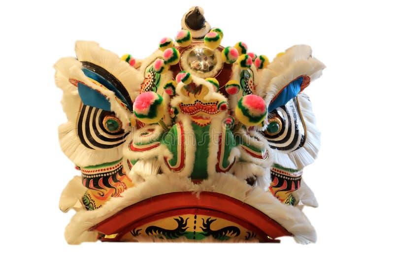 Máscara principal chinesa da dança de leão isolada no fundo branco, estilo chinês amarelo imagem de stock