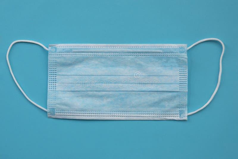 Máscara protectora quirúrgica Concepto de cuarentena del coronavirus Peligroso virus de la novela china COVID 19 y gripe imagen de archivo