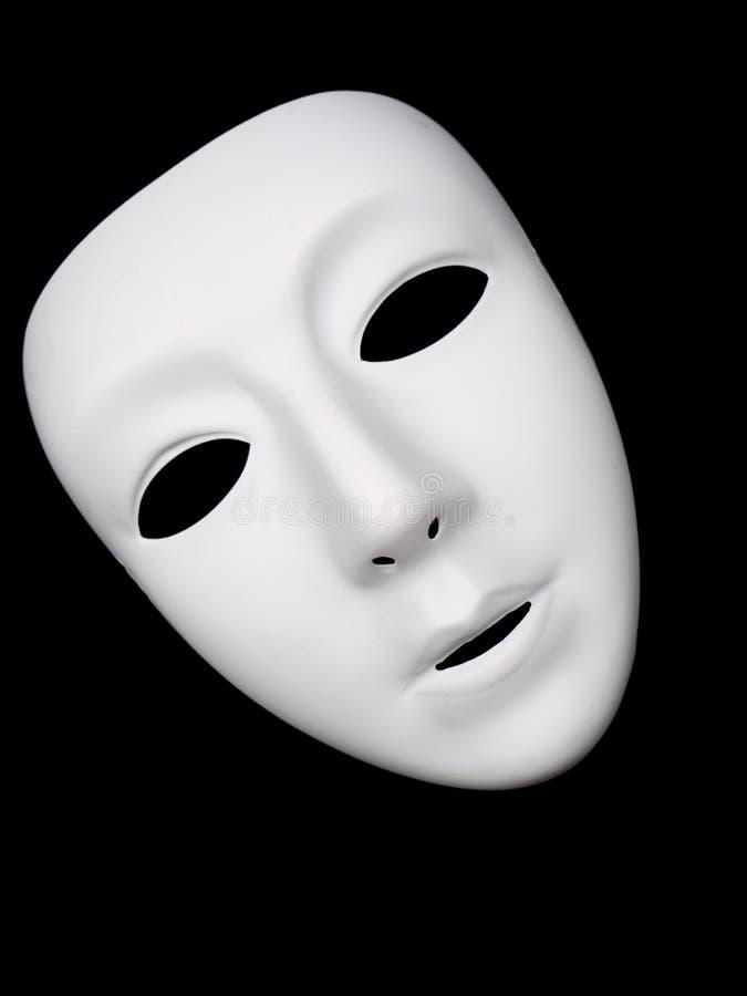 Máscara teatral branca no fundo preto fotografia de stock