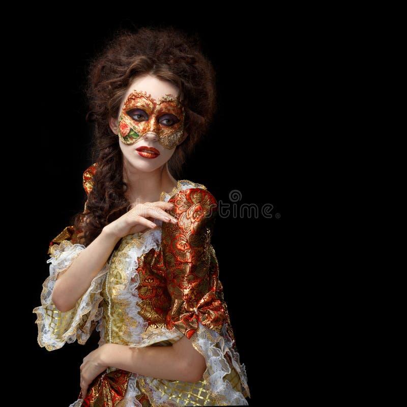 Máscara veneciana Mujer hermosa en vestido del vintage y una máscara en hola foto de archivo libre de regalías