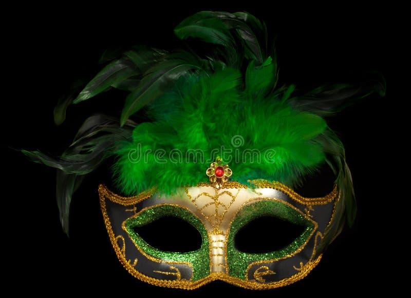 Máscara veneciana verde en negro foto de archivo