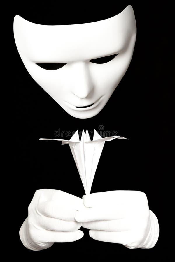 Máscara y papiroflexia blancas fotos de archivo