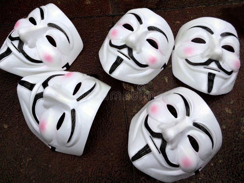 Máscaras de Guy Fawkes - membros anônimos do grupo fotografia de stock royalty free