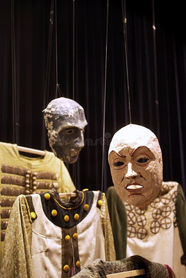 Máscaras e trajes fotografia de stock royalty free
