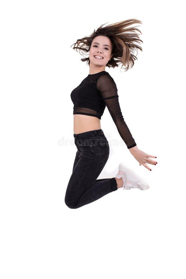 Mädchentänzer, der oben auf weißes lokalisiert springt lizenzfreies stockfoto
