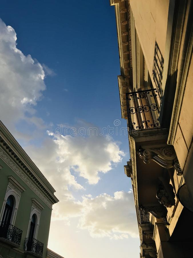 Glowing clouds and Facades over the city of Merida, Mexico - MEXICO royalty free stock image