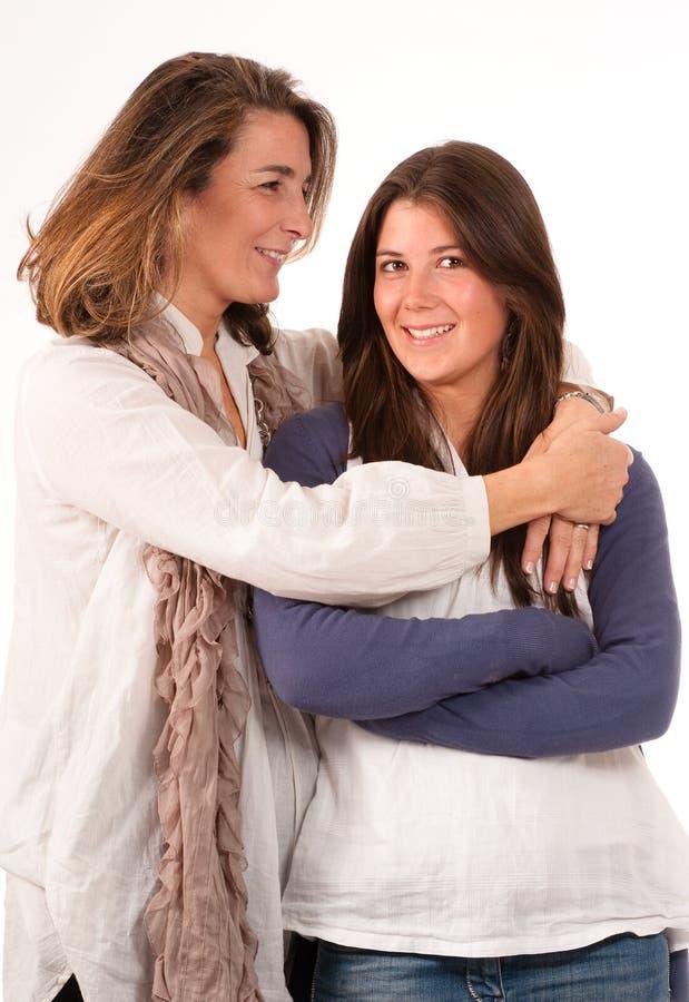 Mãe loving com filha adolescente fotos de stock royalty free