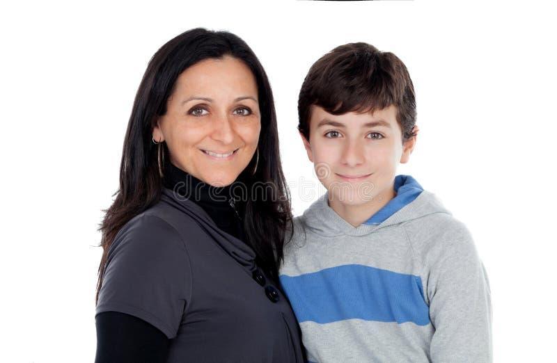 Mãe moreno com seu filho do adolescente fotografia de stock royalty free
