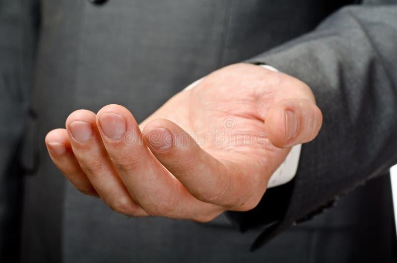 Mão aberta vazia do homem de negócios fotos de stock royalty free