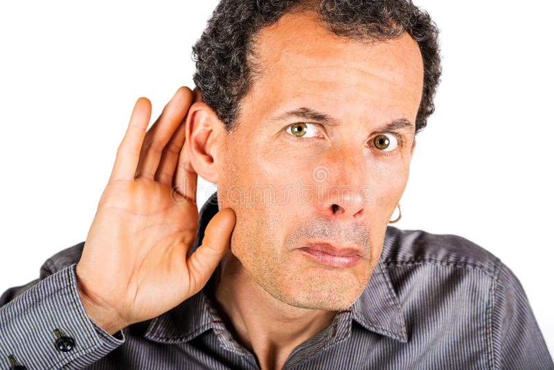 Mão colocando do homem atrás da orelha fotografia de stock