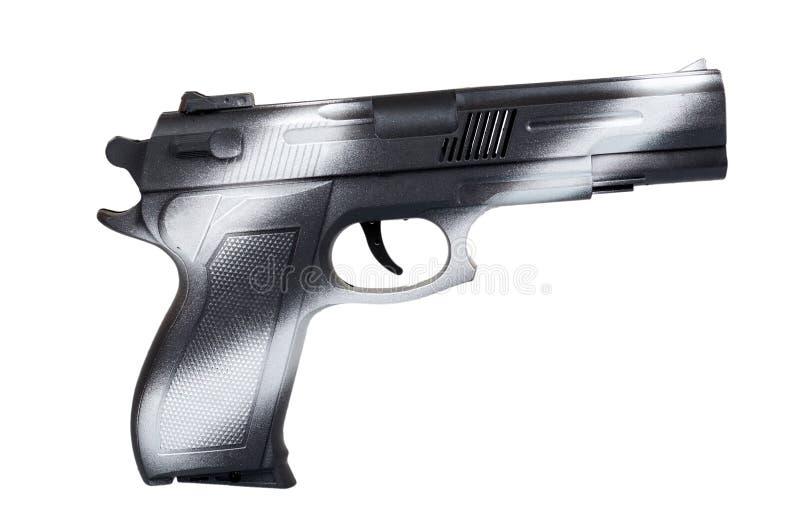 Mão com arma preta, pistola da vista lateral, crime e conceito militar imagem de stock royalty free