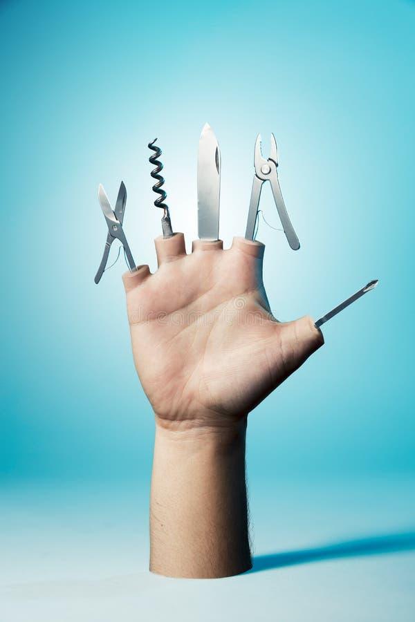Mão com as ferramentas como os dedos foto de stock royalty free