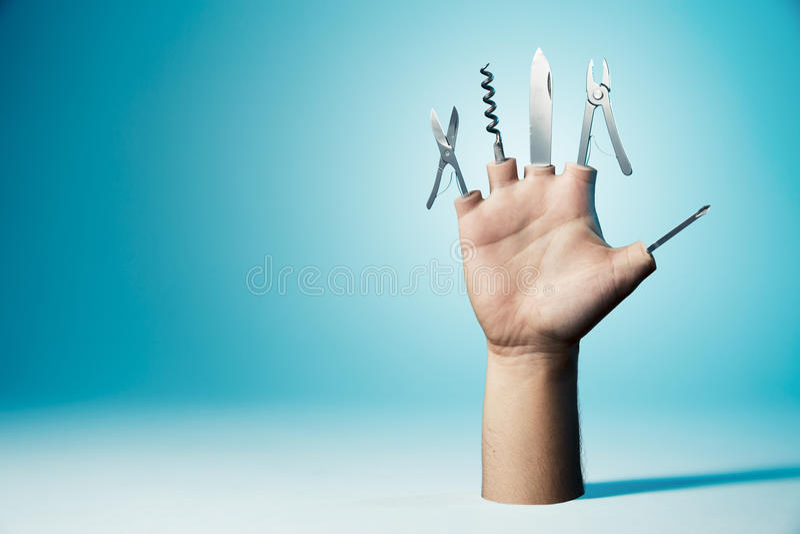 Mão com as ferramentas como os dedos imagem de stock royalty free