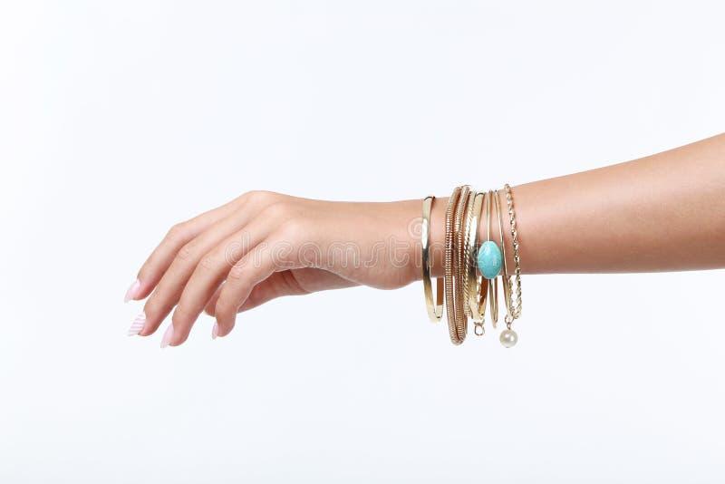 Mão com braceletes imagens de stock royalty free