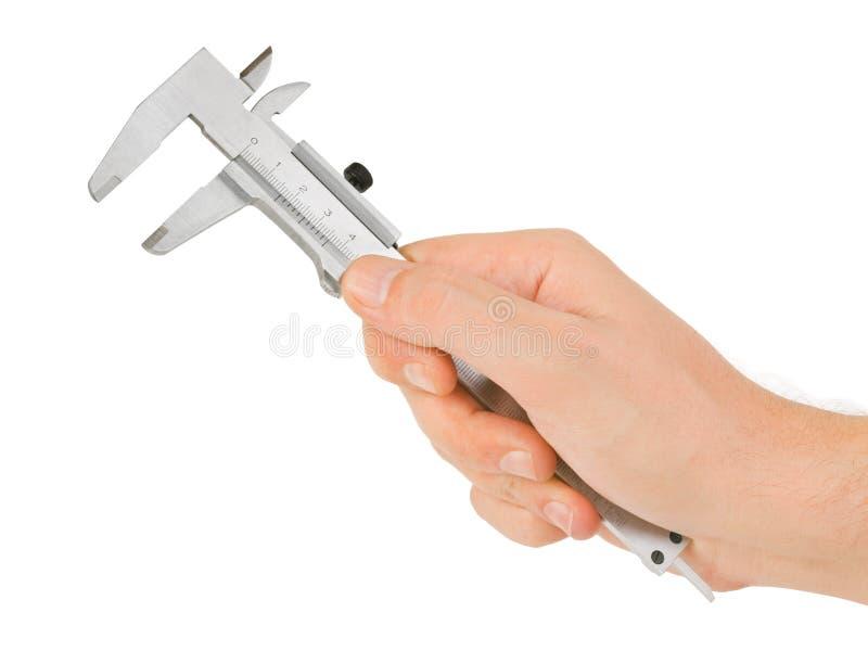 Mão com compasso de calibre fotografia de stock