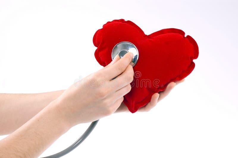 Mão com coração imagem de stock