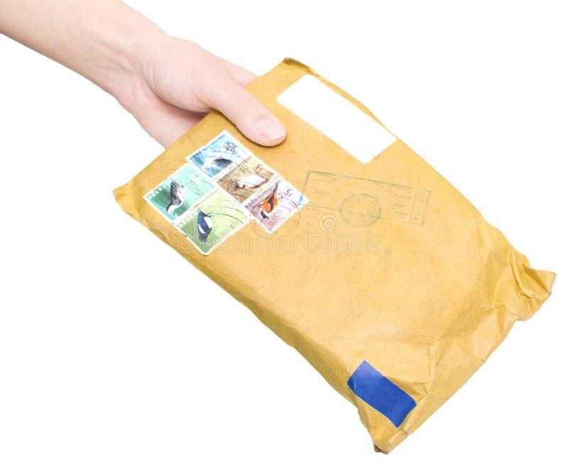 Mão com envelope fotos de stock