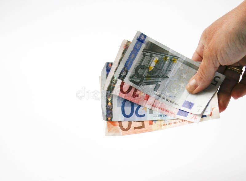 Mão com euro- contas fotos de stock royalty free