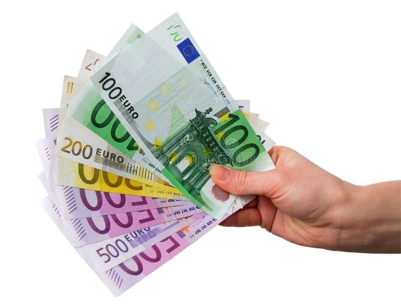 Mão com euro- notas foto de stock