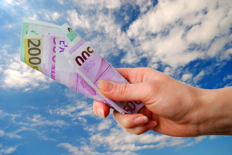 Mão com euro- notas de banco foto de stock royalty free