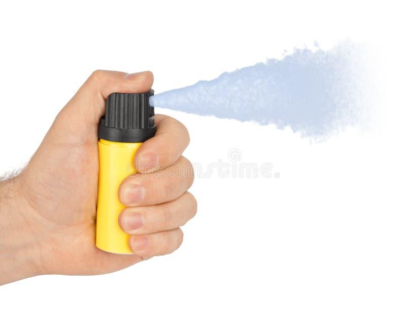 Mão com a garrafa do spray de pimenta fotografia de stock royalty free