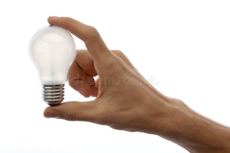 Mão com lâmpada imagem de stock