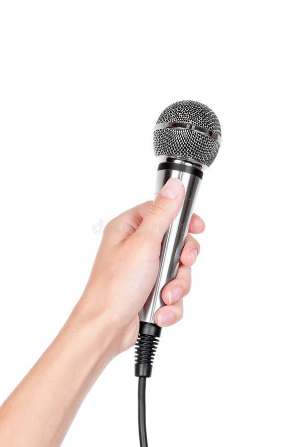 Mão com microfone foto de stock
