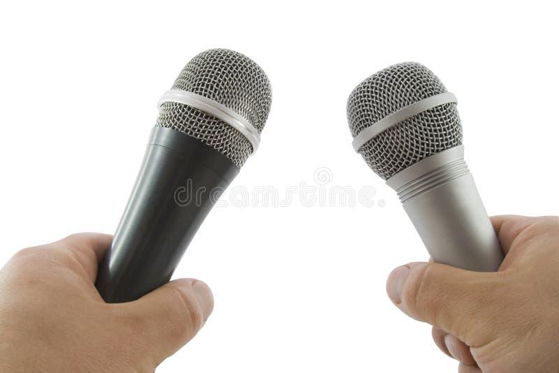 Mão com microfone sem fio fotos de stock royalty free