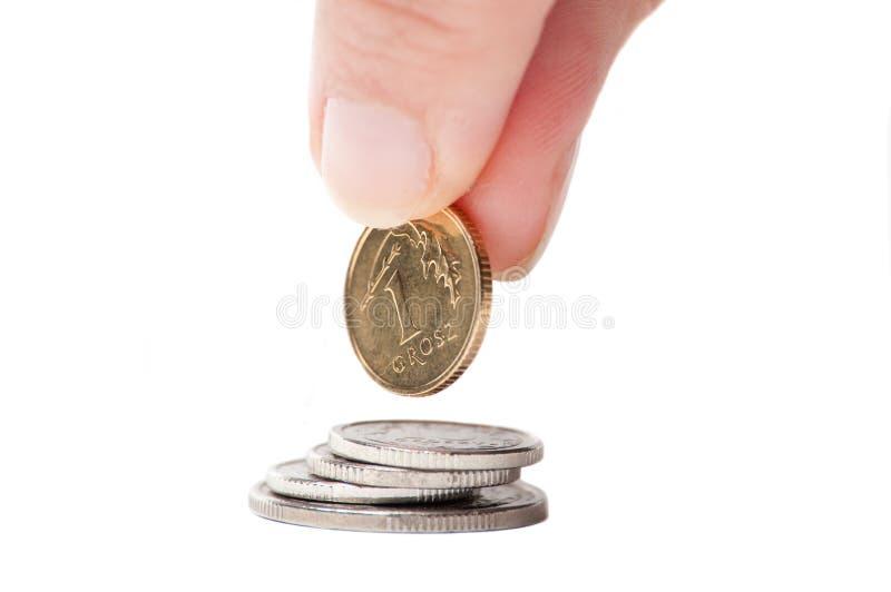 Mão com moeda polonesa fotografia de stock