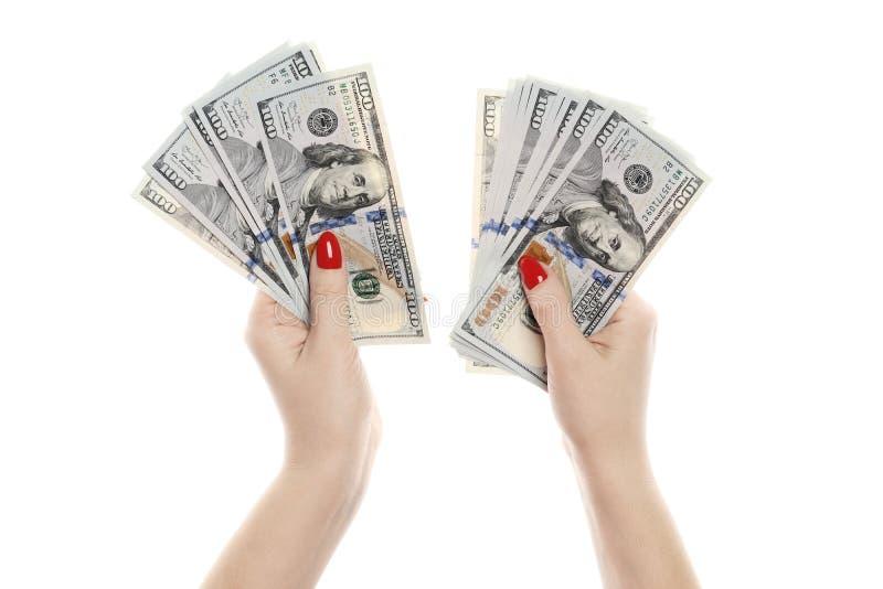 Mão com o dinheiro isolado em um fundo branco imagens de stock royalty free