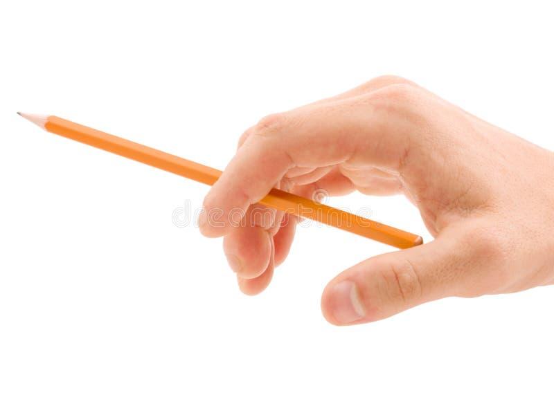 Mão com o lápis amarelo isolado no fundo branco fotos de stock royalty free