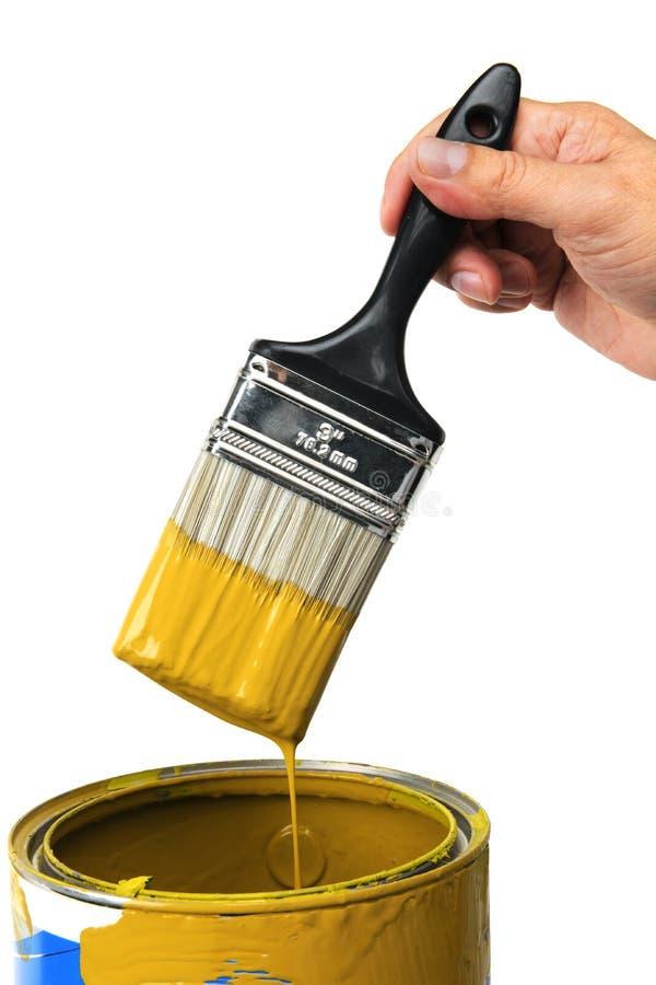 Mão com pintura amarela fotografia de stock