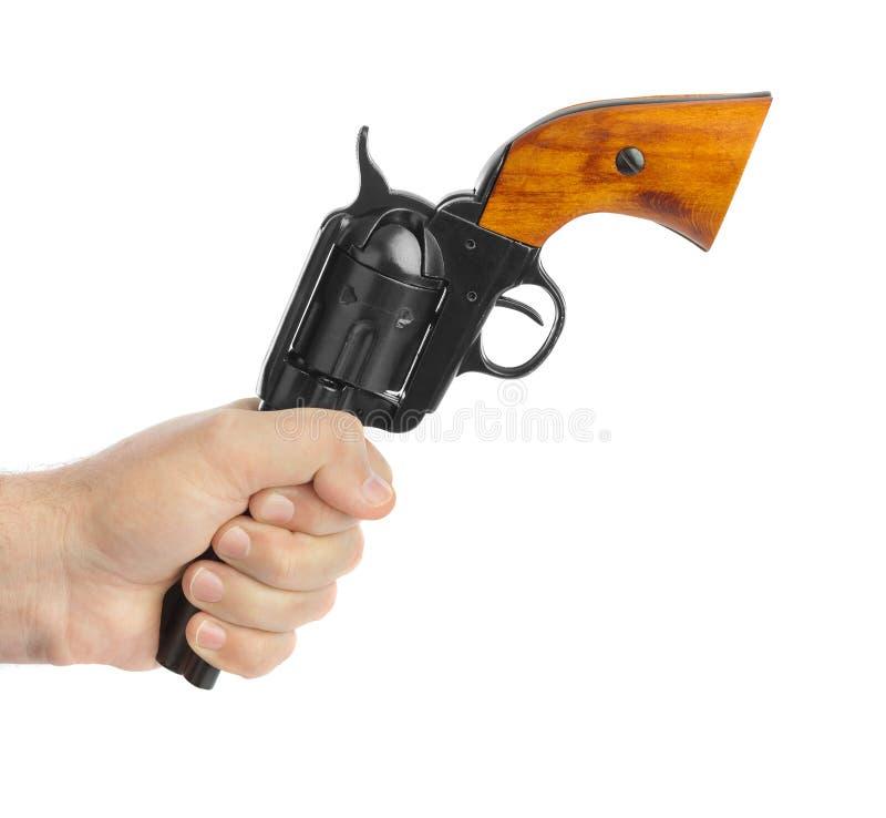 Mão com revólver foto de stock