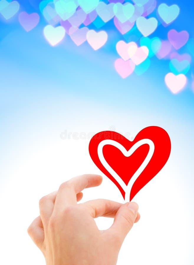 Mão com um coração fotos de stock