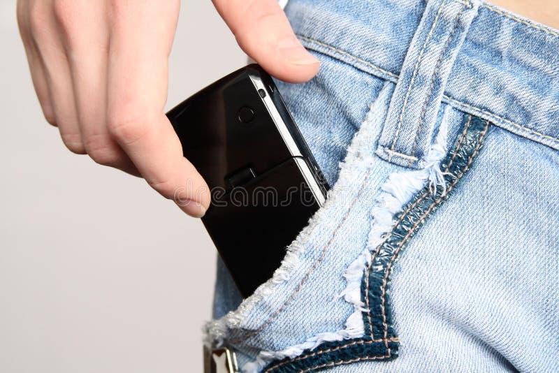 Mão com um telefone móvel imagens de stock