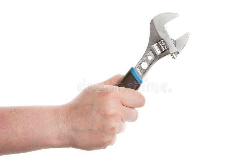 Mão com uma chave fotografia de stock royalty free