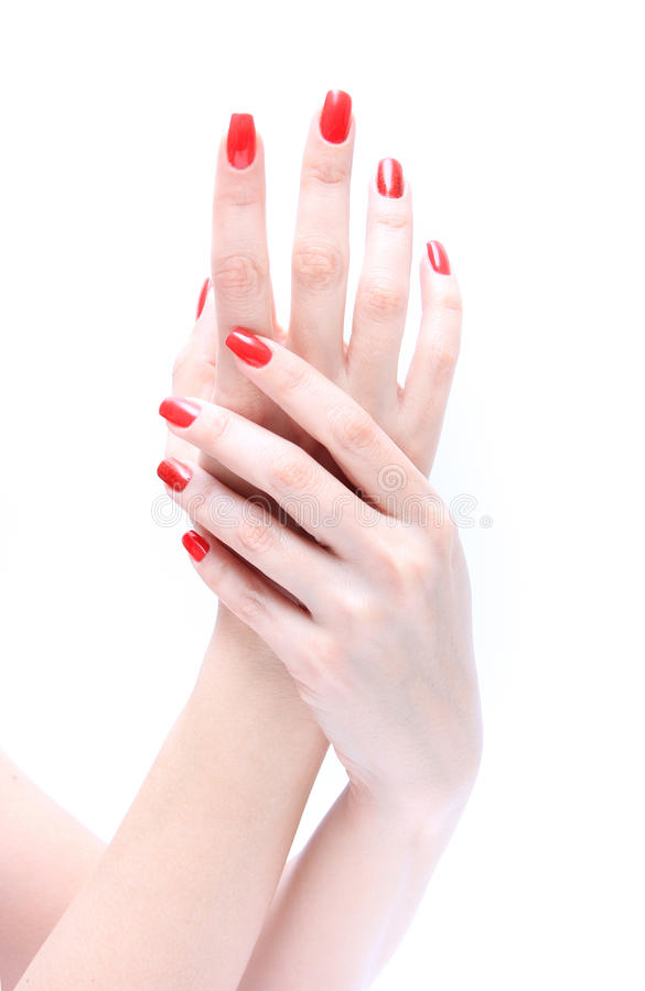 Mão com vermelho do prego fotos de stock royalty free