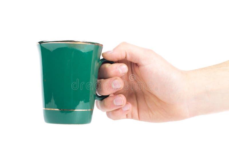 Mão com a xícara de chá verde isolada em um branco foto de stock royalty free