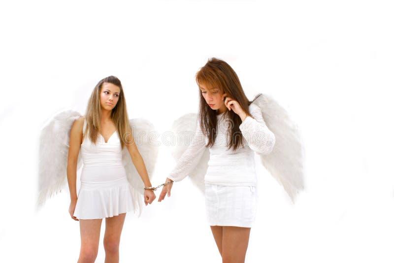 A mão Cuffed anjos imagem de stock royalty free