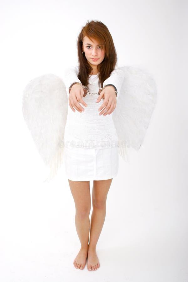 A mão Cuffed o anjo imagem de stock royalty free