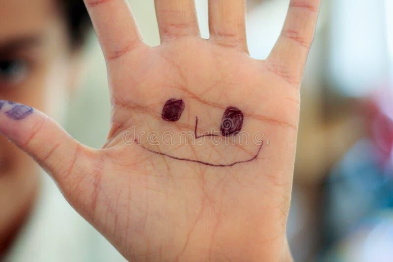 Mão da criança com face do smiley imagem de stock royalty free