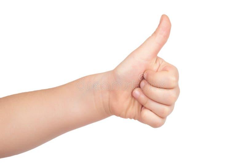 A mão da criança mostra o polegar acima do gesto, isolado no fundo branco imagens de stock royalty free