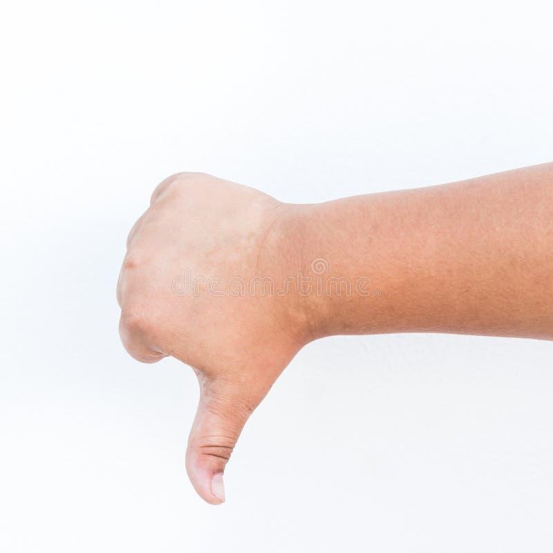 A mão da criança que mostra um polegar gesticula para baixo Isolado fotos de stock royalty free