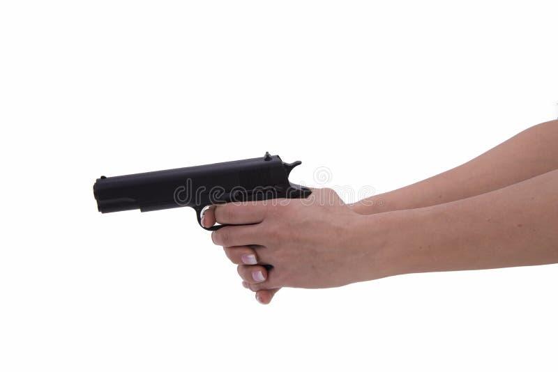 Mão da mulher com arma imagens de stock royalty free