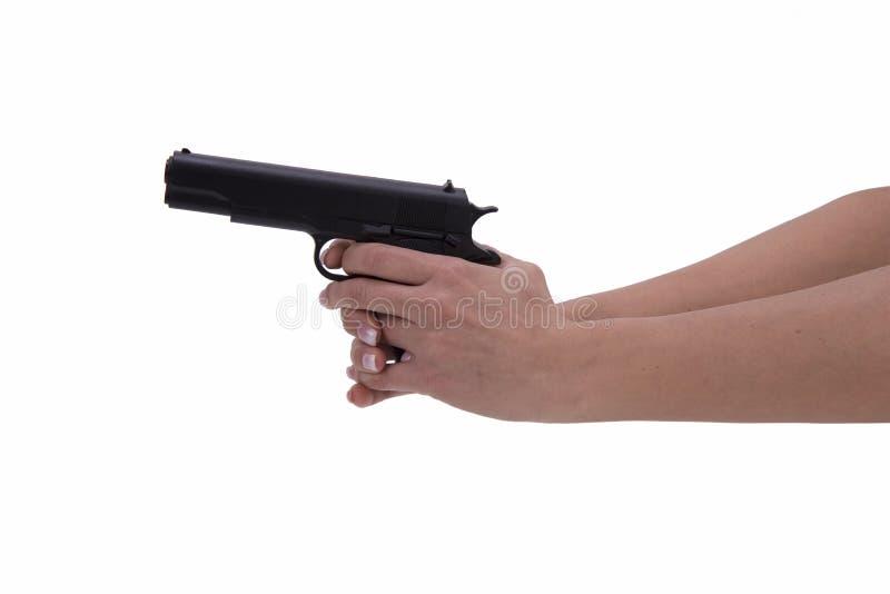 Mão da mulher com arma fotos de stock royalty free